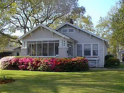 Bungalow Style 1 Story Front Gabled House With Offset Projecting Entrance Porch Bracketed Eaves Triple Pyramidal Posts On Brick Piers